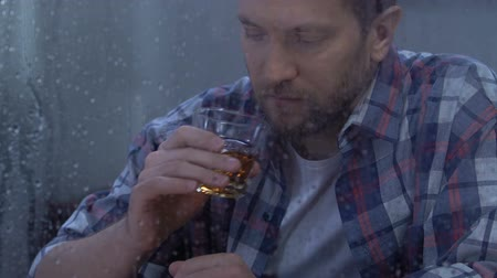 alışkanlık : Lonely middle-aged depressed male drinking alcohol, willpower absence, addiction Stok Video