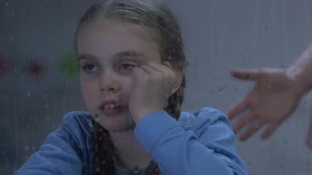 napětí : Lady shouting at little crying girl sitting near rainy window, child humiliation Dostupné videozáznamy