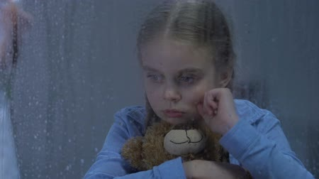 homesick : Little upset girl crying and hugging teddy bear, nurse preparing injection, cure