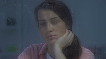 ümitsizlik : Unhappy depressed lonely lady sitting behind rainy window, suffering divorce