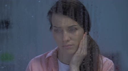 ümitsizlik : Depressed lady crying behind rainy window suffering depression after divorce