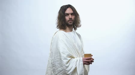 communion : Good Jesus holding wooden cup, religious concept to give drink to thirsty Stock Footage