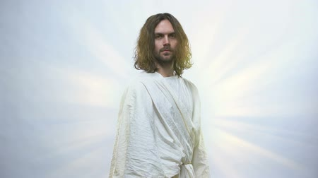 radiante : Jesus turning to camera on shiny background, looking with compassion and love