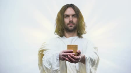 communion : Son of God holding wine, sacramental Eucharist in Catholic church, Communion Stock Footage