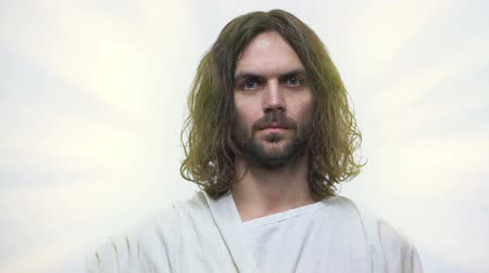 megváltás : Jesus looking on camera with love, concept of God mercy and forgiveness, closeup