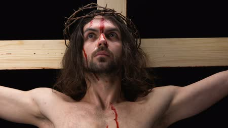 crucified : Christian martyr waiting for God coming, tears and blood, forgiveness of sins