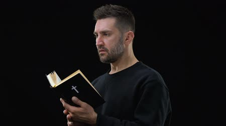 bible black : Religious believer holding bible, finding answers to questions, faith in God