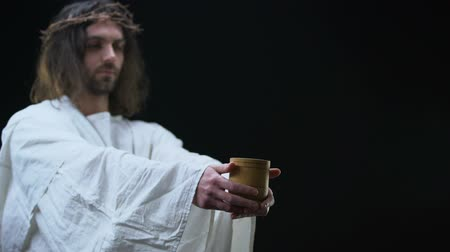 resurrection : Holy savior giving cup of water poor man, religious mercy, kindness and charity Stock Footage