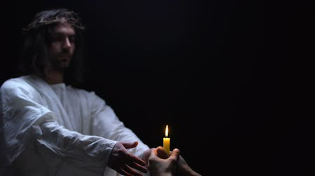 fiel : Savior supporting religious man holding candle, spiritual ritual, God kindness Stock Footage
