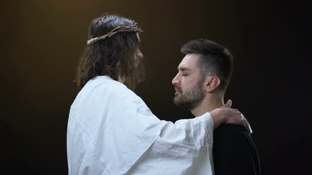 megváltás : Son of God hugging crying male, sins forgiveness, soul salvation, religious love.
