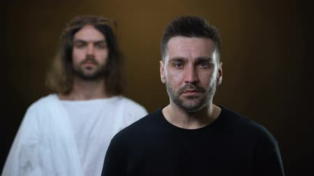 salvezza : Crying depressed man feeling support of God, Jesus putting hand on male shoulder