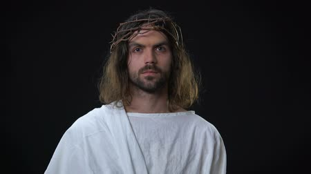 jezus : Crying savior in crown of thorns and white cloth, suffering for human sins