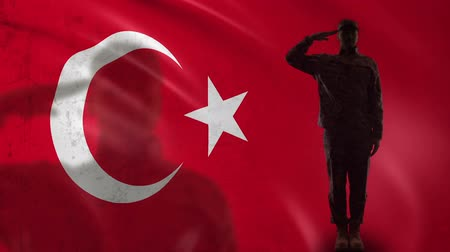 peacekeeping : Turkish soldier silhouette saluting against national flag, army conscription