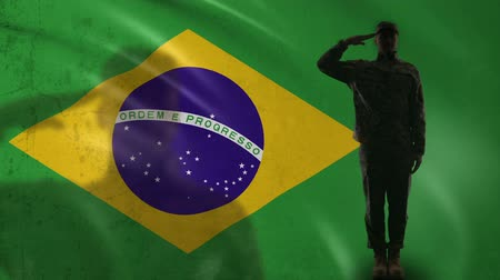 peacekeeping : Brazilian soldier silhouette saluting against national flag military recruitment