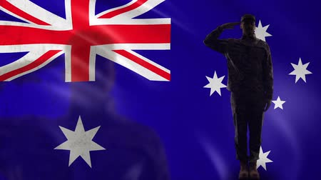veterano : Australian soldier silhouette saluting against national flag, country protection