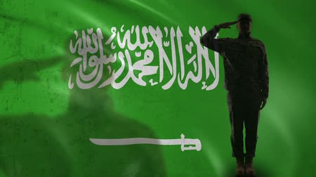 герой : Saudi Arabian soldier silhouette saluting against national flag, country pride