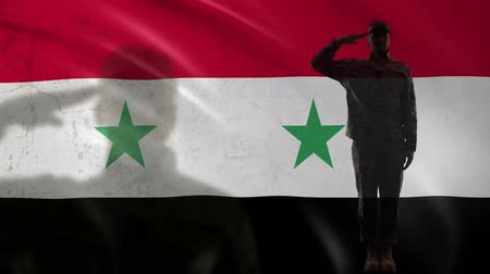peacekeeping : Syrian soldier silhouette saluting against national flag, military war tactics