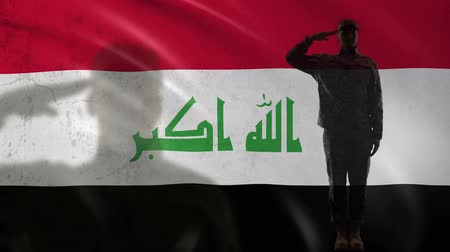 peacekeeping : Iraqi soldier silhouette saluting against national flag, proud serviceman, army Stock Footage