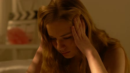 cheated : Depressed teenager girl holding head, relationship problems in young age Stock Footage