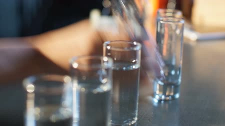 carelessness : Woman drinking set of alcohol shots, losing consciousness on bar counter