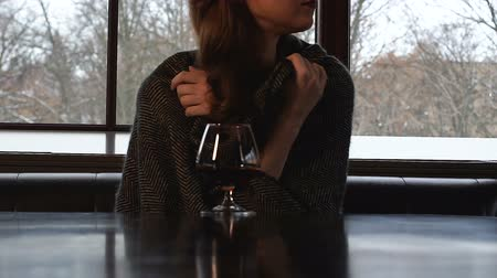 cognac : Lady in plaid trembling from cold, treating with brandy, untraditional medicine Stock Footage
