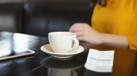 brake : Woman paying bill and leaving cafe, hurry for work, morning coffee tradition