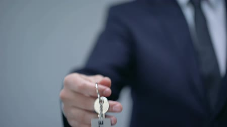 hotel suite : Suite word on keychain in businessman hand, rental premium quality accommodation Stock Footage