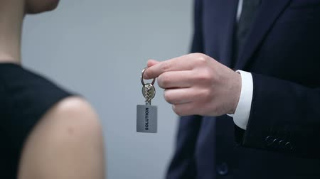 overcome : Male hand giving lady keys to Solution, help in solving business problem closeup