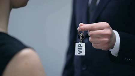 realty : Hotel administrator giving woman keys to VIP apartment, luxury hotel service Stock Footage