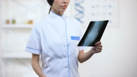the inflammation : Doctor in uniform checking bones x-rays trauma and rehabilitation period, health