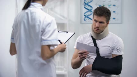 назначение : Doctor giving bill to patient in arm sling and foam collar, expensive treatment