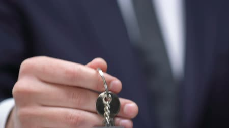 vacant : Vacant word on keychain in businessman hand, career promotion, success concept Stock Footage