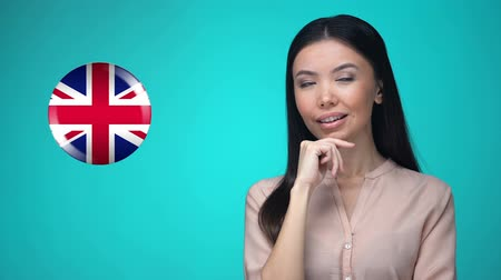 traductor : Female student pushing Great Britain flag button, ready to learn language