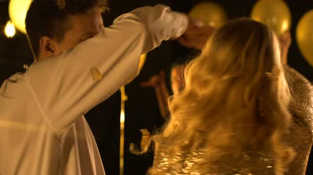 seduce : Nice Caucasian couple dancing under falling confetti, celebration together