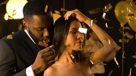 kíséret : Seductive Asian lady dancing with Black man at night club party, escort services