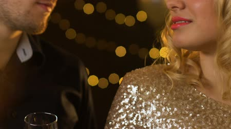 seduce : Caucasian couple clinking champagne at party, lights glowing on background Stock Footage