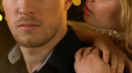 whispering : Seductive young lady whispering on handsome male ear telling secret and flirting