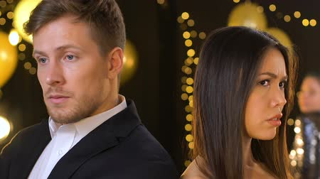 jealous : Anxious multiracial couple suffering misunderstanding at party, breakup risk