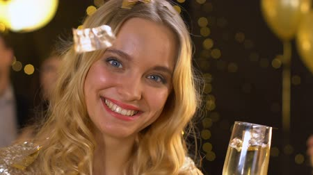 bengália : Attractive lady holding bengal light and glass of champagne at new year party Stock mozgókép