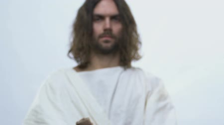 bondade : Jesus Christ reaching out hands holding bottle of holy wine, rituals, communion Stock Footage