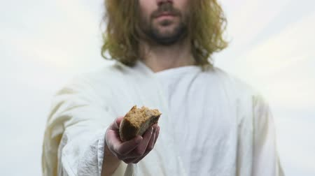 евангелие : Jesus Christ reaching out peace of bread to hungry people, alms, support of poor