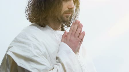 communion : Holy man in white robe praying God asking for healing and blessings of people Stock Footage
