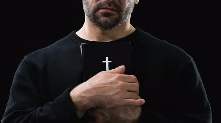 holy heaven : Desperate male sinner hugging holy bible, hope and forgiveness concept, closeup Stock Footage