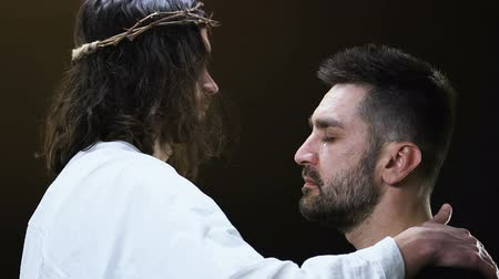 ukřižování : Jesus Christ hugging crying male parishioner, making satisfaction with sins