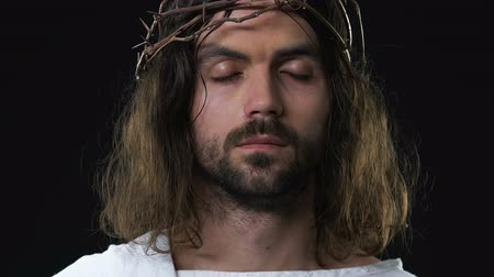 crucified : Crying Jesus Christ with eyes closed feeling sorrow for peoples sins, darkness