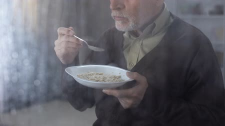 zabkása : Grandfather eating porridge at home, healthy nutrition, organic breakfast, meal
