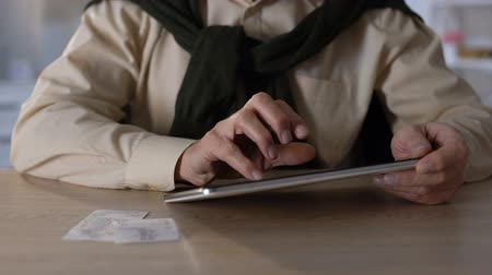 утилита : Male using saved checks and tablet to pay purchase taxes, online banking closeup Стоковые видеозаписи