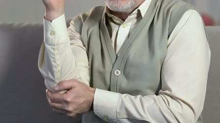 肘 : Aged man massaging elbow, joints inflammations, arthritis disease, health care