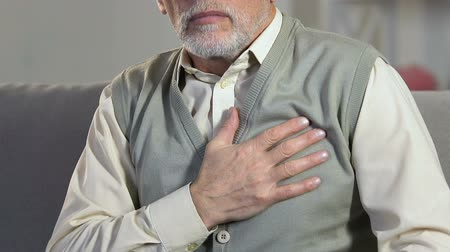 cardiological : Senior man suddenly feeling pain in chest, cardiological problem, heart attack