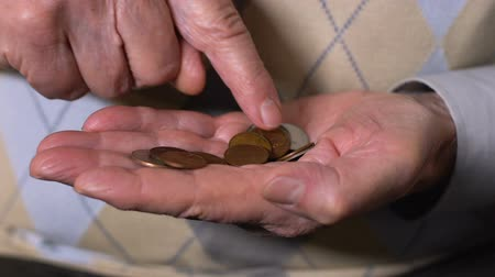 cent : Mature man counting pound cents, old age poverty, pension insurance, credit Stock Footage